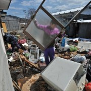 A-family-cleans-out-their-house-in-the-tsunami-devastated-town-of-Otsuchi